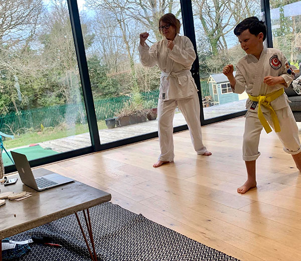 Parents and children enjoying a live streamed karate lesson
