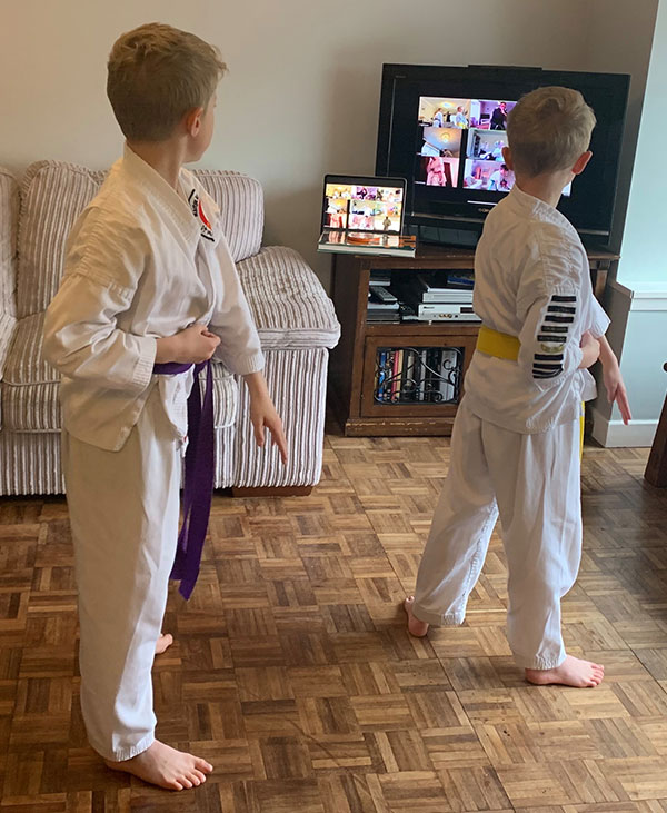Teenagers enjoying a live streamed karate lesson